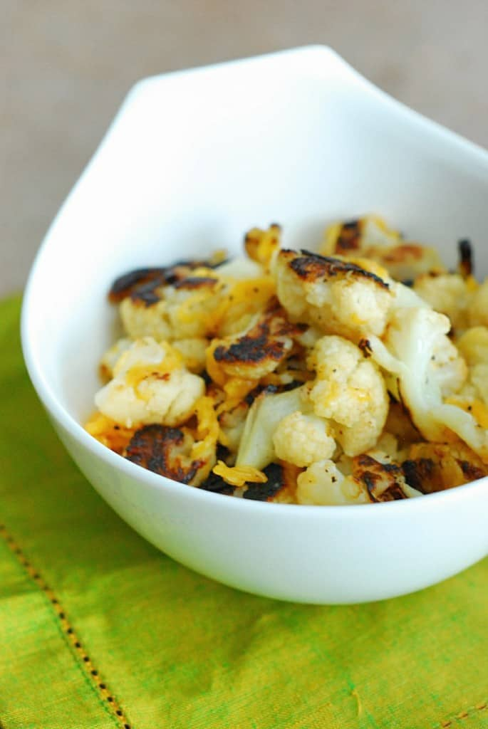 Best Roasted Cauliflower EVER - Healthy mouth watering side dish that's sure to please your pickiest eaters.