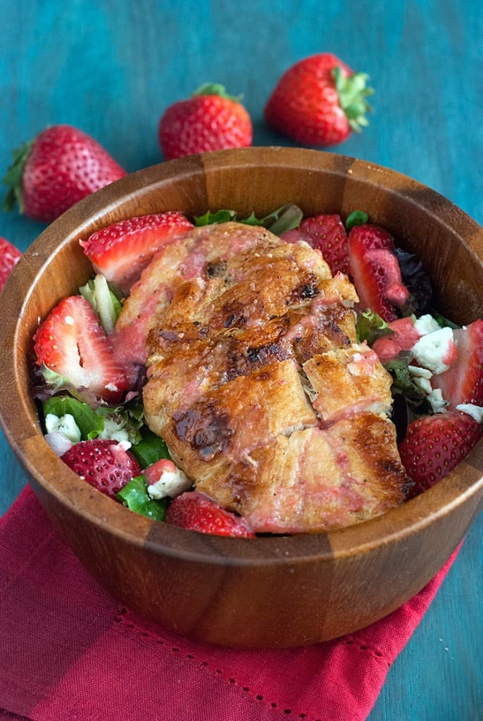 Strawberry Chicken Salad - If you take a look around your favorite produce department or farmer's market, you may notice that it's the height of strawberry season, making it a perfect time to use those bright, sweet berries in as many recipes as possible. This grilled chicken salad recipe pairs tender chicken with beautiful berries to give you a delicious, nutritious entree.